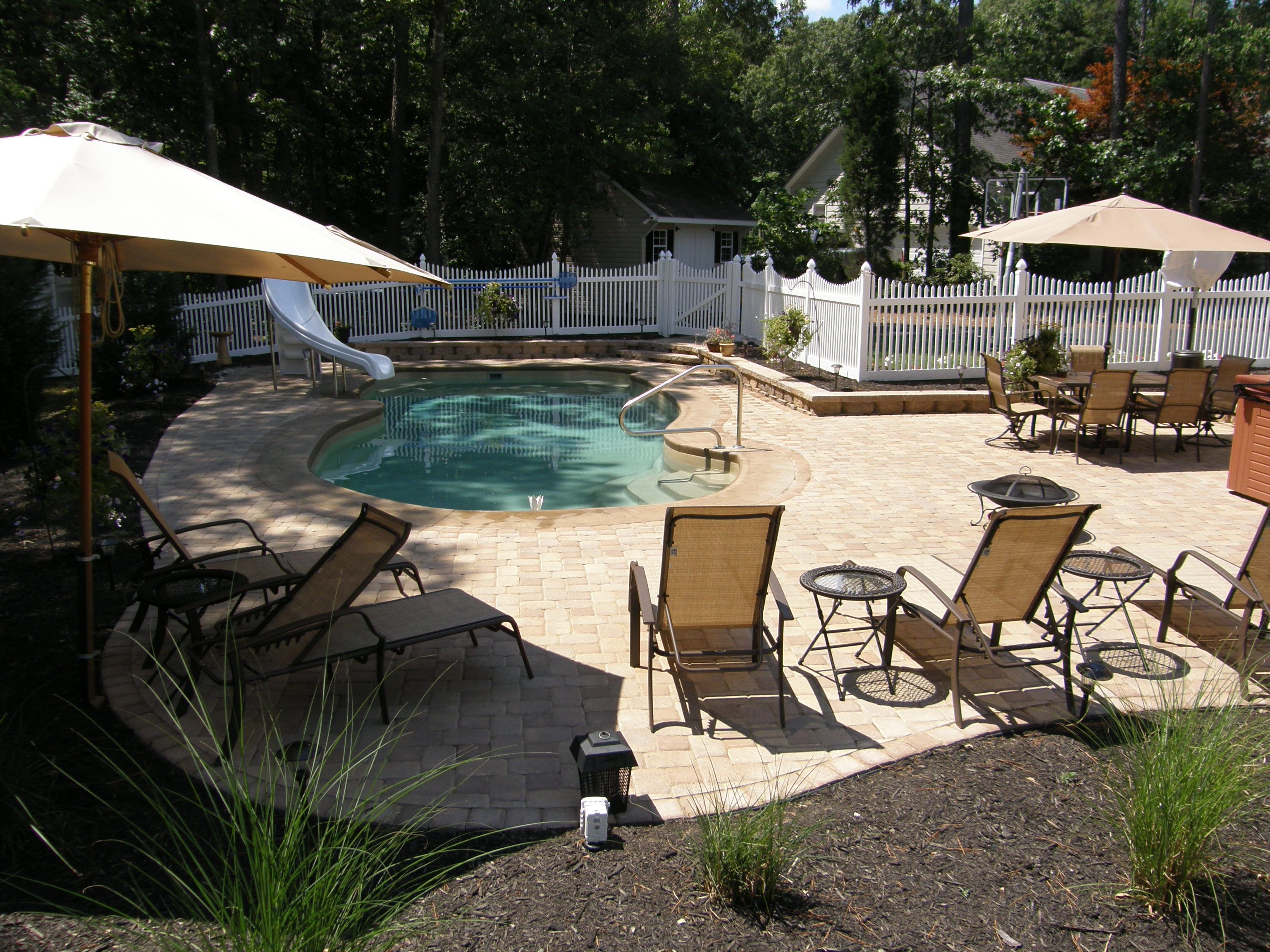 Pool Patio Materials Stamped Concrete Vs Pavers Pools Pool