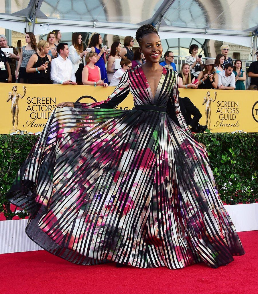 Lupita Nyong'o in a colorful gown.