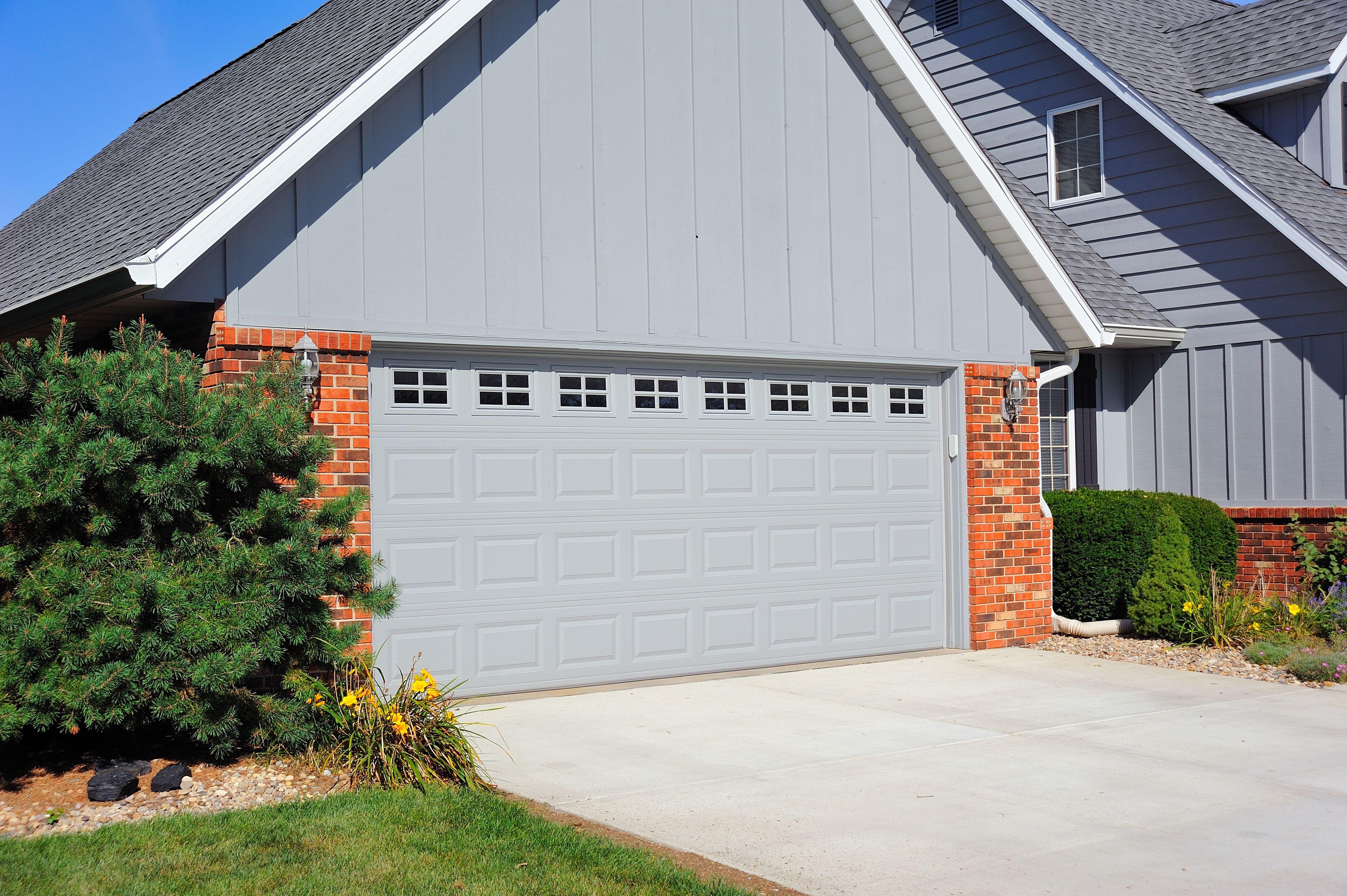 Glass overhead doors -  C H I Overhead Doors Steel Raised Panel Garage Doors In Grey With Stockton Glass
