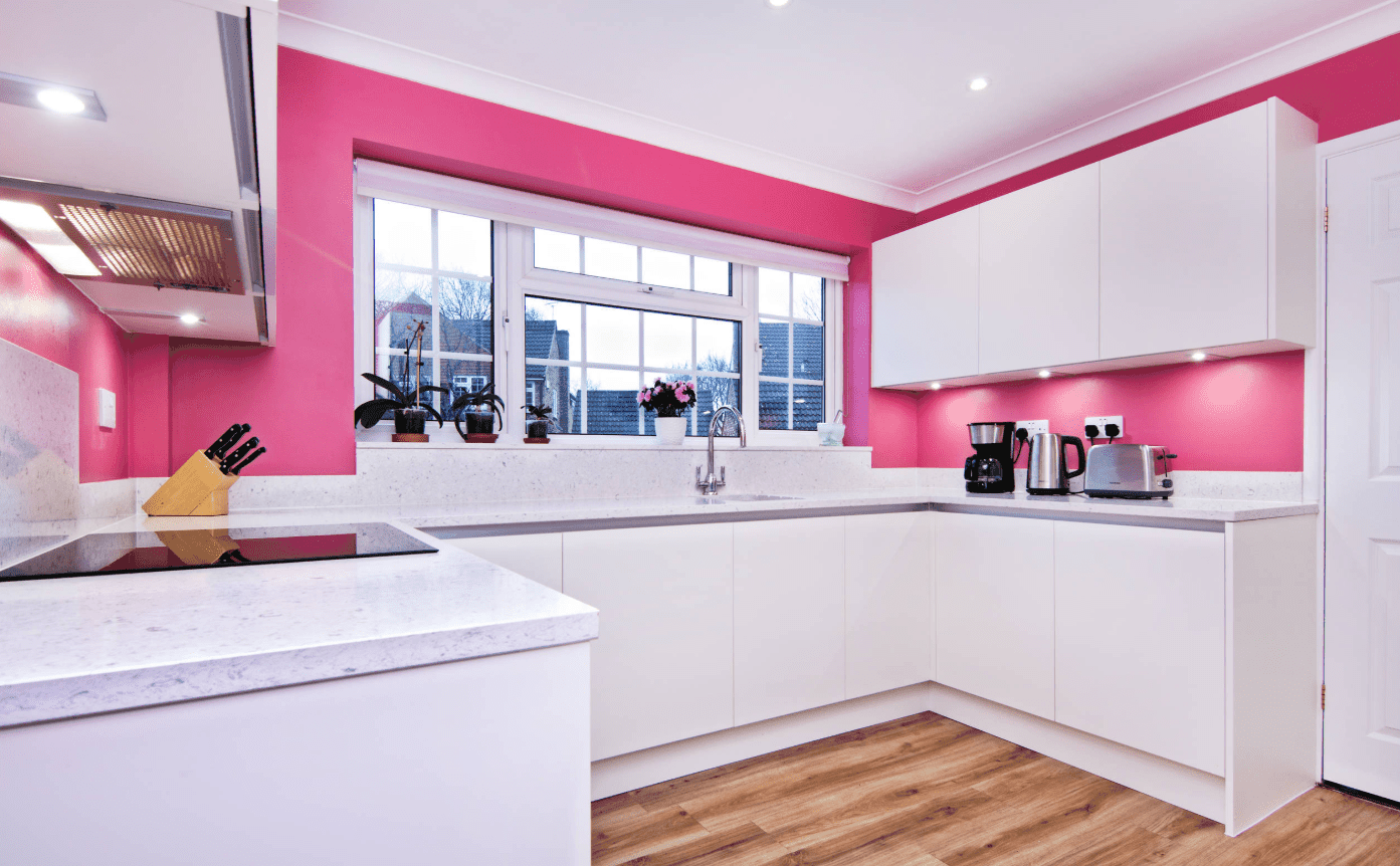 Modern Kitchen With Pink Walls And Hardwood Flooring It Includes White Cabinetry With Built In Lights And Marble Co Pink Kitchen Purple Kitchen Kitchen Colors