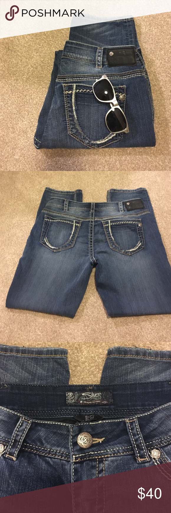 "Silver jeans (Suki Slim) size 32/L29 straight leg Kinda dark wash with fading. Suki slim L9216ssf272.. Great detail on back pockets .. No rips or stains. Gently used condition.. Measures:: 15 1/2"" waist 9"" rise 20 1/2"" hips laid flat .. SFH really nice or to tuck in boots or wear with flats. Silver Jeans Jeans Straight Leg"