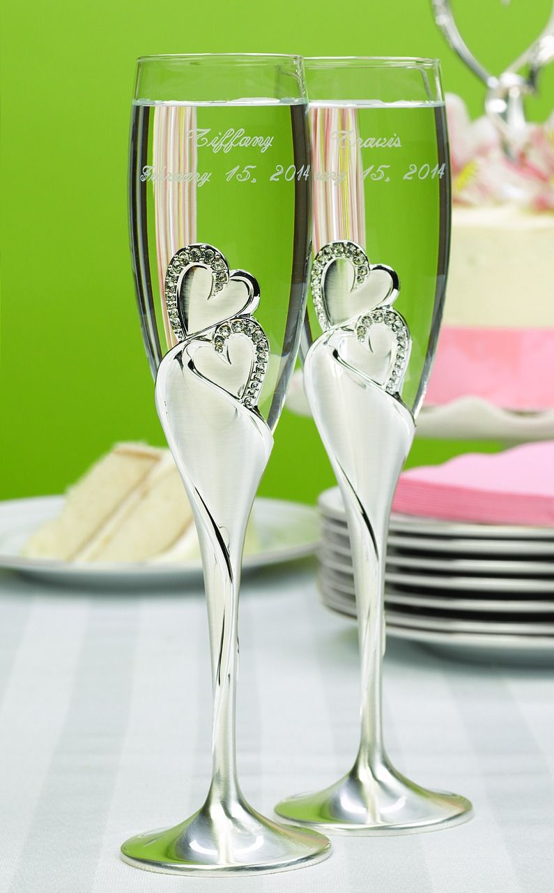 Toasting Glasses for the Wedding Rhinestone Heart Accented Wedding toasting glasses that feature sparkling rhinestone heart accents that the bride and groom can sip champagne from at their reception toasting ceremony.