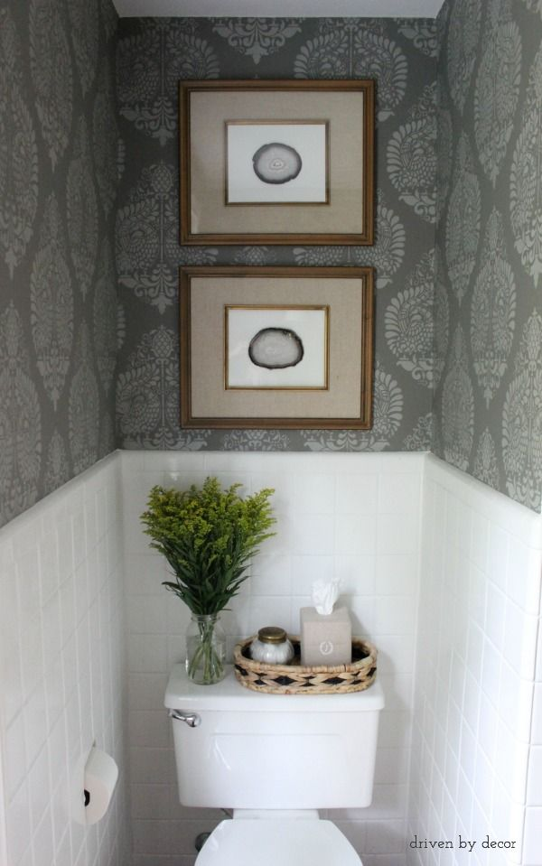Inexpensive DIY agate art in stacked frames above toilet