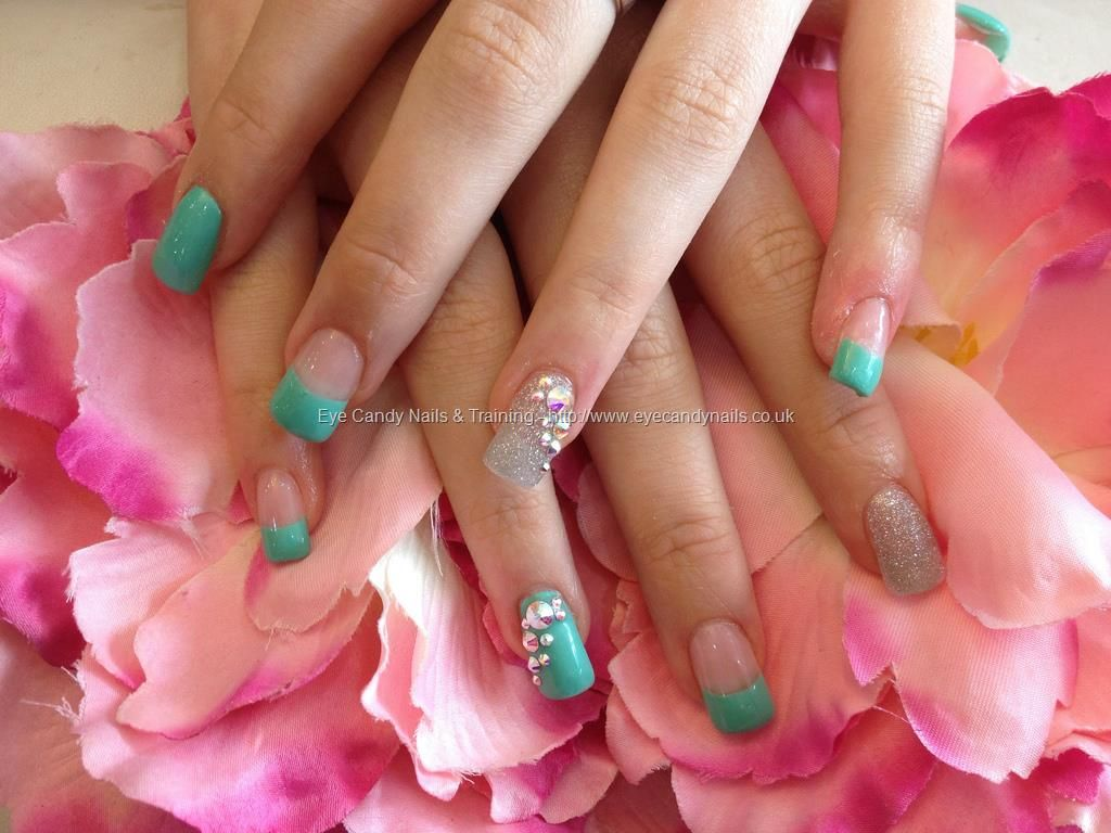 Acrylic nails with green gel polish and Swarovski crystals on ring ...