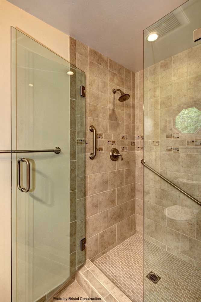 Traditional Shower With A Standard Gold Shower Head Large Square Tiles All Around A Glass Shower Door An With Images Glass Shower Doors Shower Doors Replace Shower Door