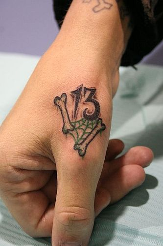 Friday the 13th tattoo by TattoosbyPanda, via Flickr Maybe not the placement but I like the design