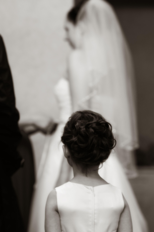 flower girl watching bride