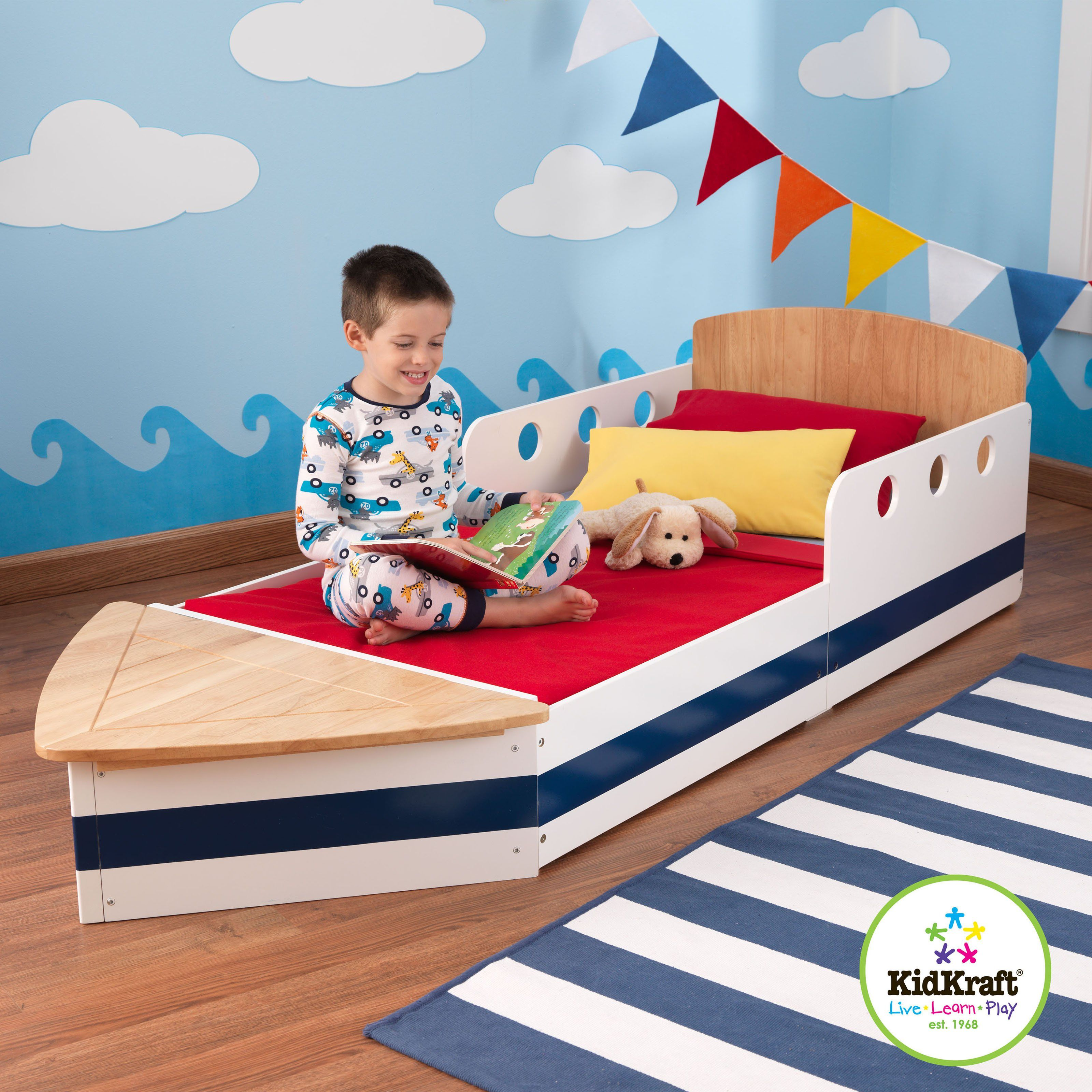 Kidkraft boat toddler bed 76251 your child can pretend that hes sailing the high seas in this bed without any worries of seasickness and that means