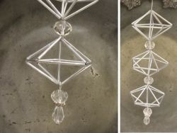 Another interesting combination of shapes for himmeli-type ornaments. Could use glass tube beads, straws, or brass tubing. Put beads in between prisms for a long, dangling ornament. Pretty!
