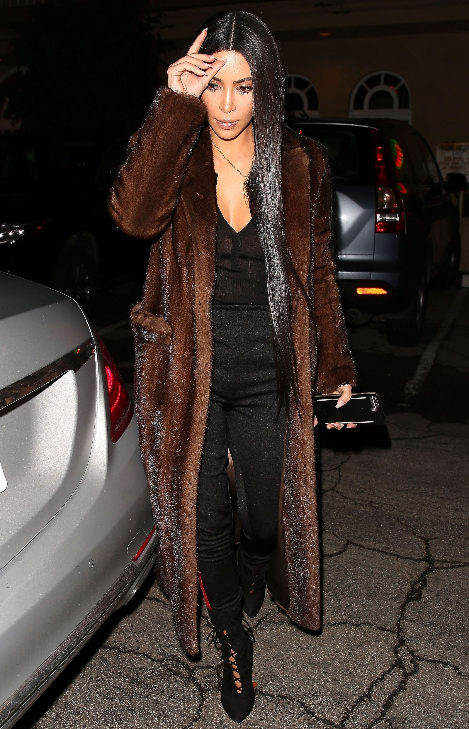 Kim Kardashian S Money Printed Coat And More Of Her Best New Looks Brown Fur Coat Brown Faux Fur Coat Fur Coat Outfit