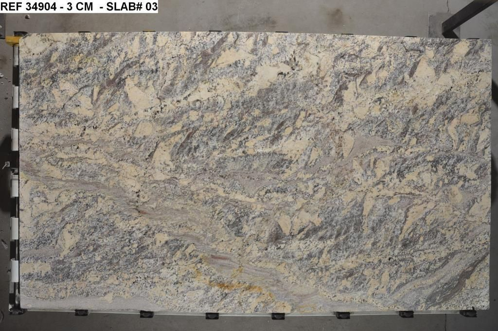 Netuno Bordeaux Granite Has An Overall Cream Gray Color With Strong Wavy Patterns Of Browns Whites And Grays Close Up This Granit Rochas Ornamentais Rochas