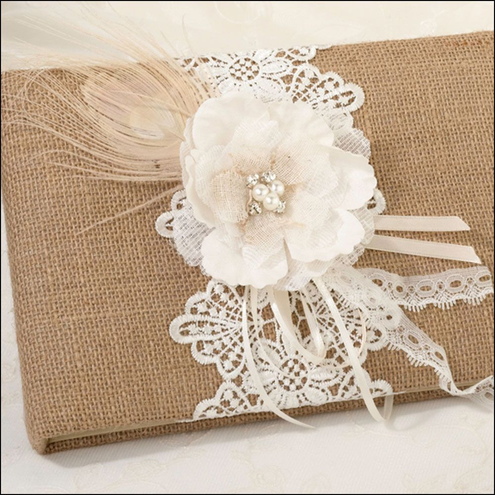 Burlap wedding guest book with a natural peacock feather ribbons