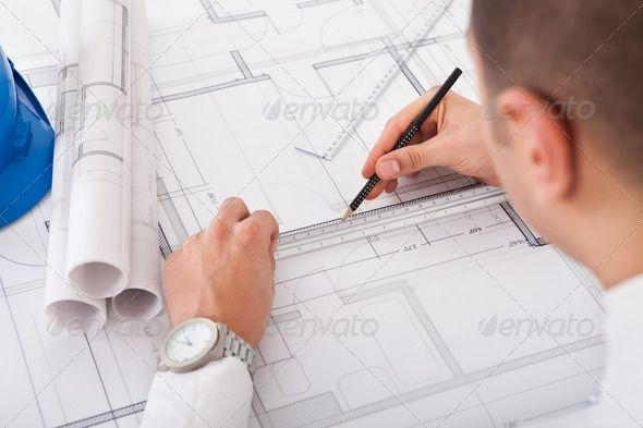 Architect working on blueprint design 20s accuracy adult architect working on blueprint design 20s accuracy adult architect malvernweather Choice Image