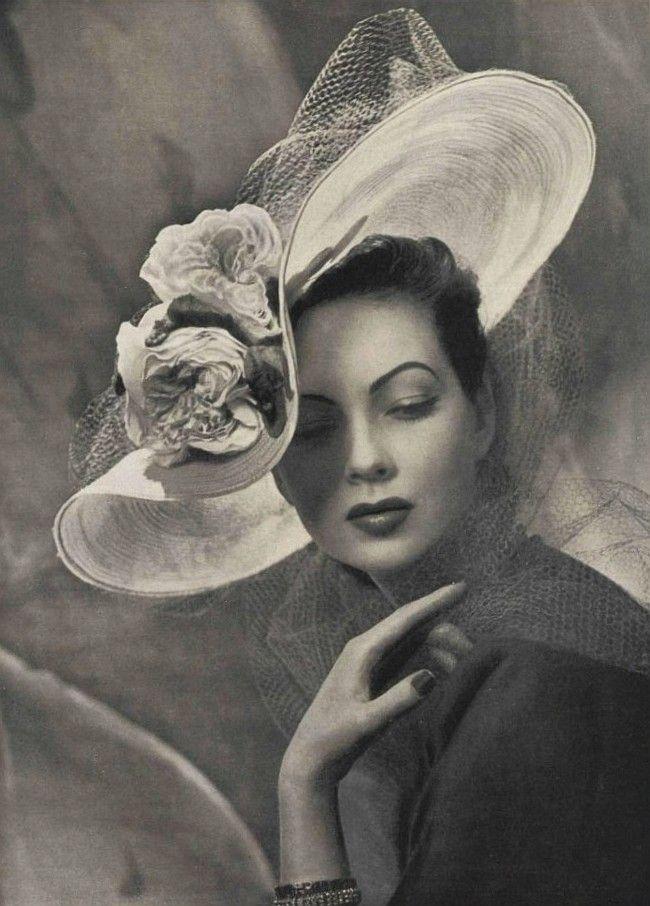 so pretty... love this hat...    D'un extreme a l'autre  L'Officiel #299, 1947  Photographer: Philippe Pottier  Hat by Maud et Nano