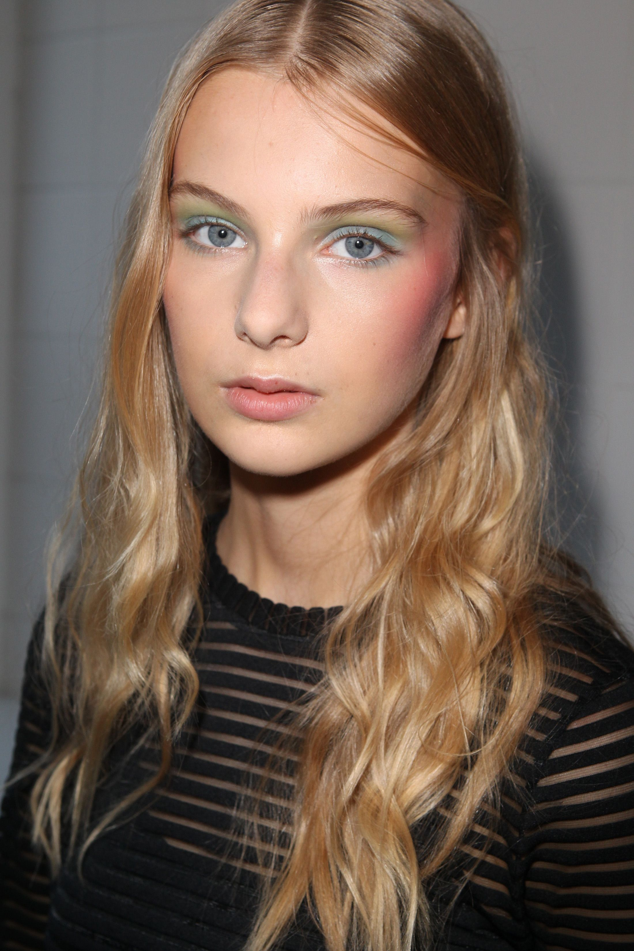 """""""70s tropical eyes"""" were created by makeup artist Lloyd Simmonds at Alexis Mabille in Paris. MAC Pro Paint Sticks in Hi-Def Cyan and Primary Yellow were applied in stripes, with a mixture of the two in the middle. The cheeks were a colourful affair, too, with a wash of blush high up on the cheekbones. - Cosmopolitan.co.uk"""