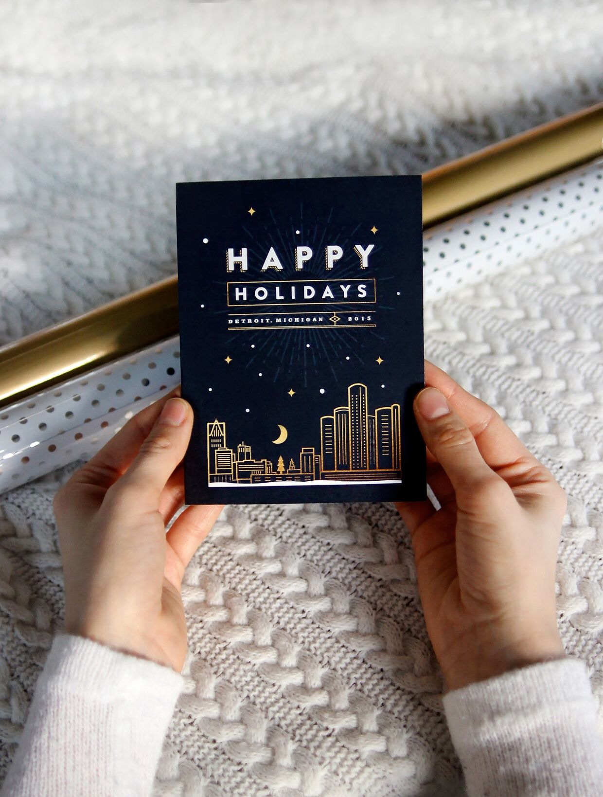 Holiday Greeting Card With Gold And Navy Colors Featuring A Skyline