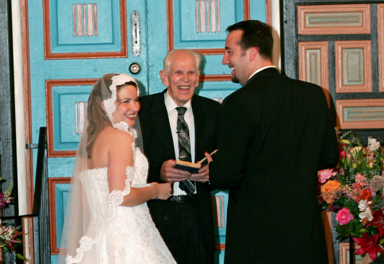 """A happy couple saying """"I Do"""" in our Santa Fe Room"""