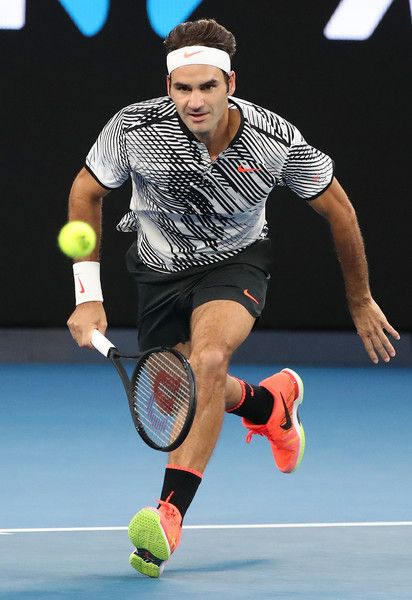 Roger Federer Photos Photos - Roger Federer of Switzerland chases down the  ball in his quarterfinal