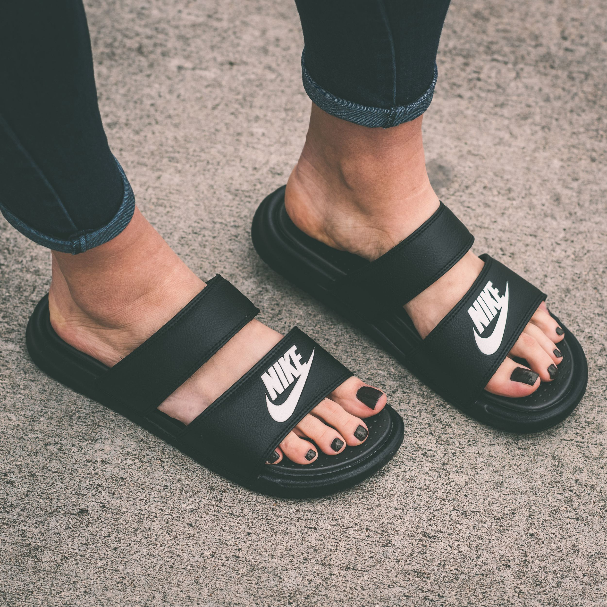 Nike has modified the Benassi slide from traditional to sporty with a new  distinct silhouette. A duo of synthetic leather straps overlay the forefoot  in ... 0f6bff2c9d