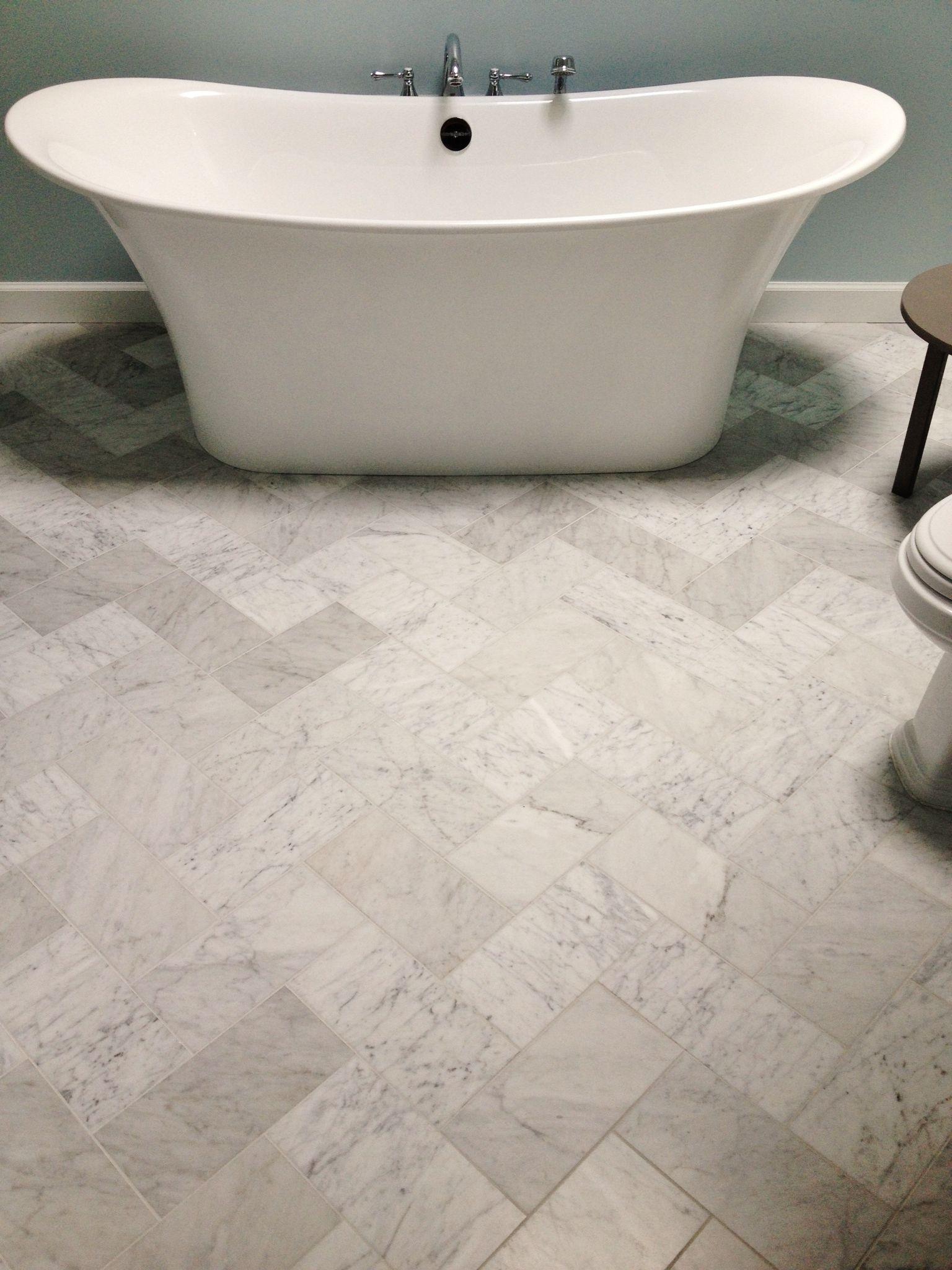 6x12 Venetino Marble Tiles Set In The Herringbone Pattern On This Master Bathroom Floor