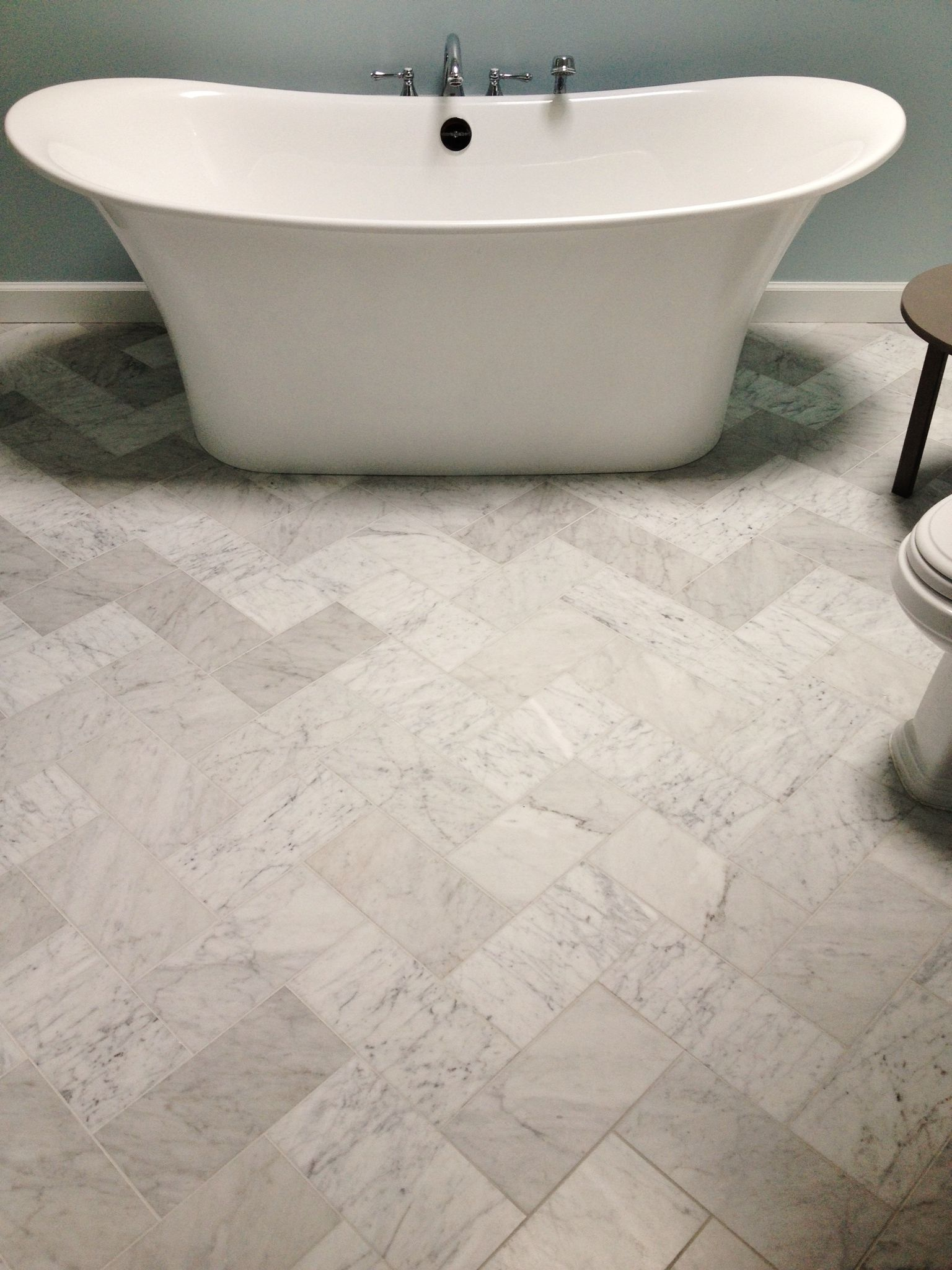 6x12 Venetino marble tiles set in the herringbone pattern on this