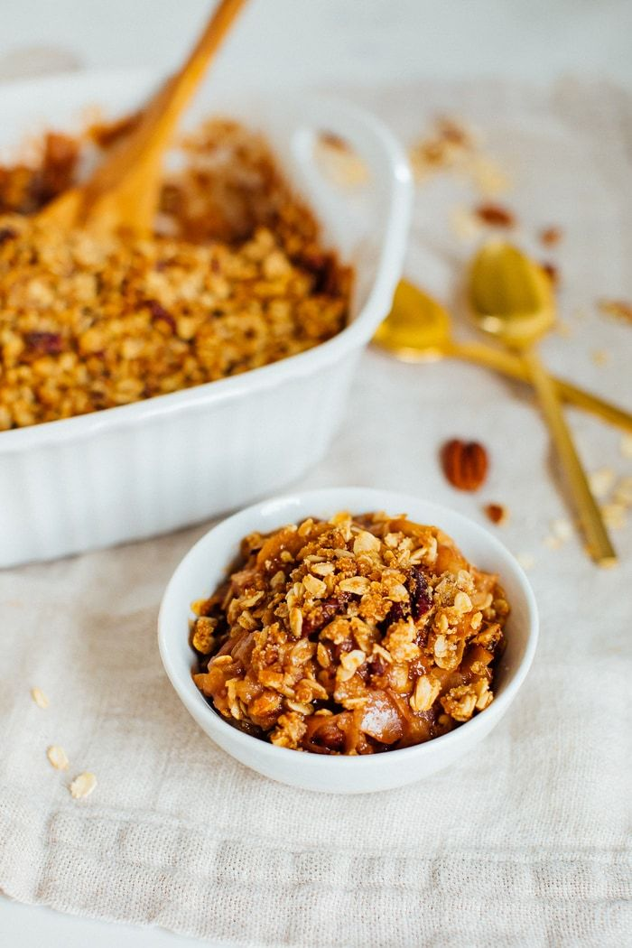 This delicious and healthy apple crisp is super easy to whip up and easily made gluten-free and vegan! Cinnamon baked apples topped with the crispy, nutty, oatmeal topping is perfection.#eatingbirdfood
