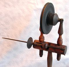 Miner's Head Spindle Spinning Wheels  Old Sturbridge Village: Minor's patent accelerating spinning wheel head. Minor of Marcellas, New York patented his improvements to spinning wheel heads in 1803 and 1810. Minor's patent greatly increased the speed of rotation of the spindle of wool wheels by adding a second pulley between the great wheel and the spindle pulley, more than doubling the spindle's velocity. This increased speed of rotation imparted more twist to the yarn with less effort.
