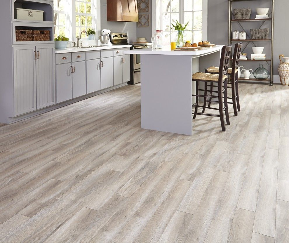 Light Grey Brown Laminate Flooring Kitchen Maintaining Floor Durability And Warmth With Ceramic Tile That Loo Kitchen Flooring Flooring Trends House Flooring