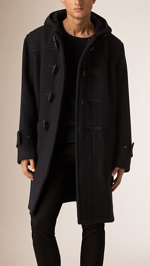 c54eb7e2a2f19 Burberry long duffle coat in a warm wool and mohair. The hooded design  features a traditional toggle closure