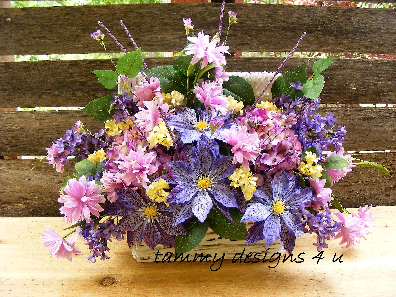 White wicker basket floral arrangement purple hydrangea lilac