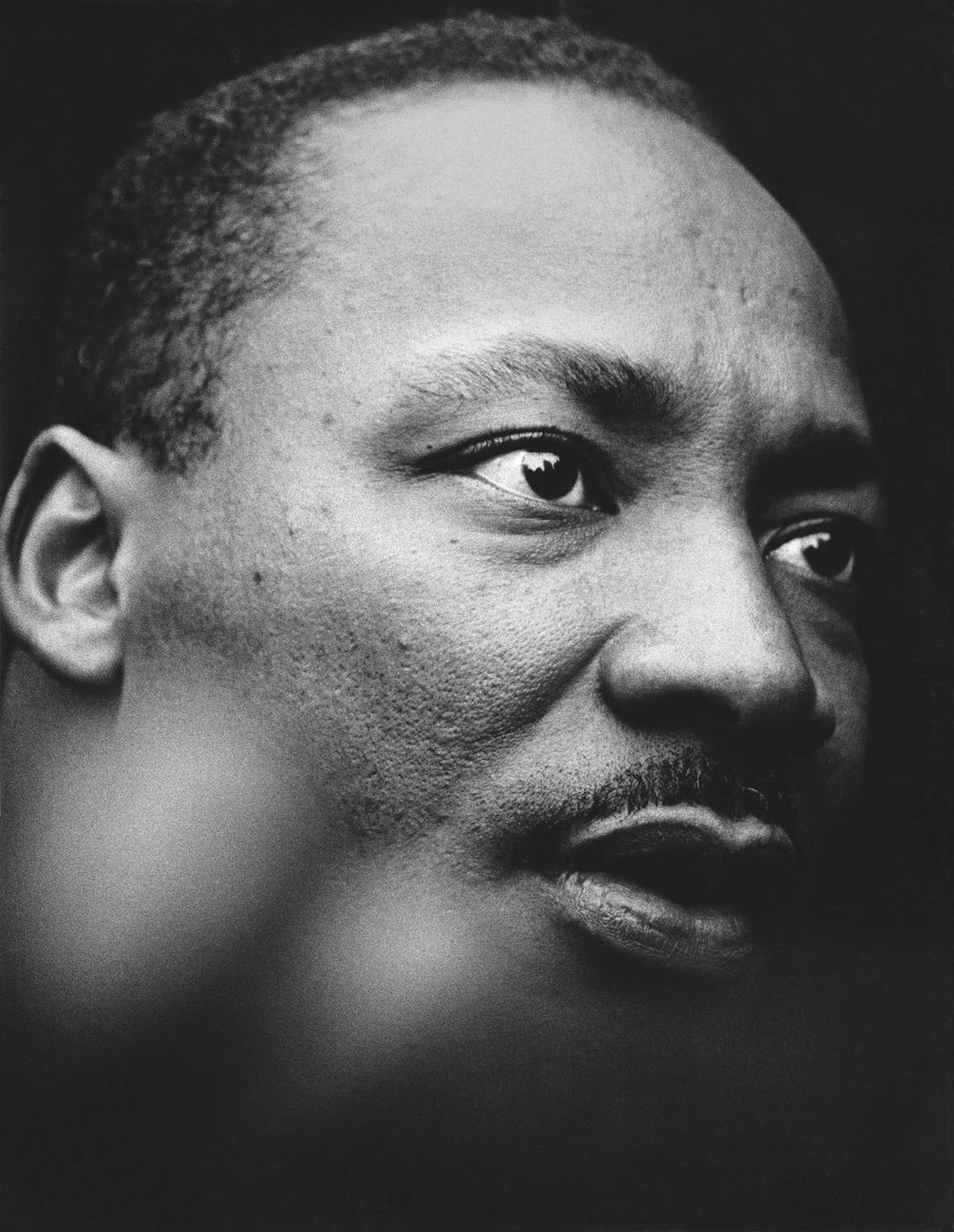 © Jean-Pierre Laffont, April 15, 1967, Martin Luther King Jr.  MLK outside the UN building delivering a speech denouncing the Vietnam War. We can see the UN building reflected in his eyes.  » more pictures of Martin Luther King, Jr. « | » more photos...