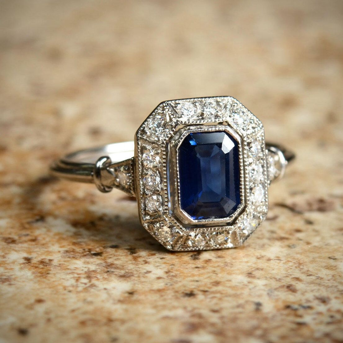 Blue natural sapphire diamond halo and platinum ring in