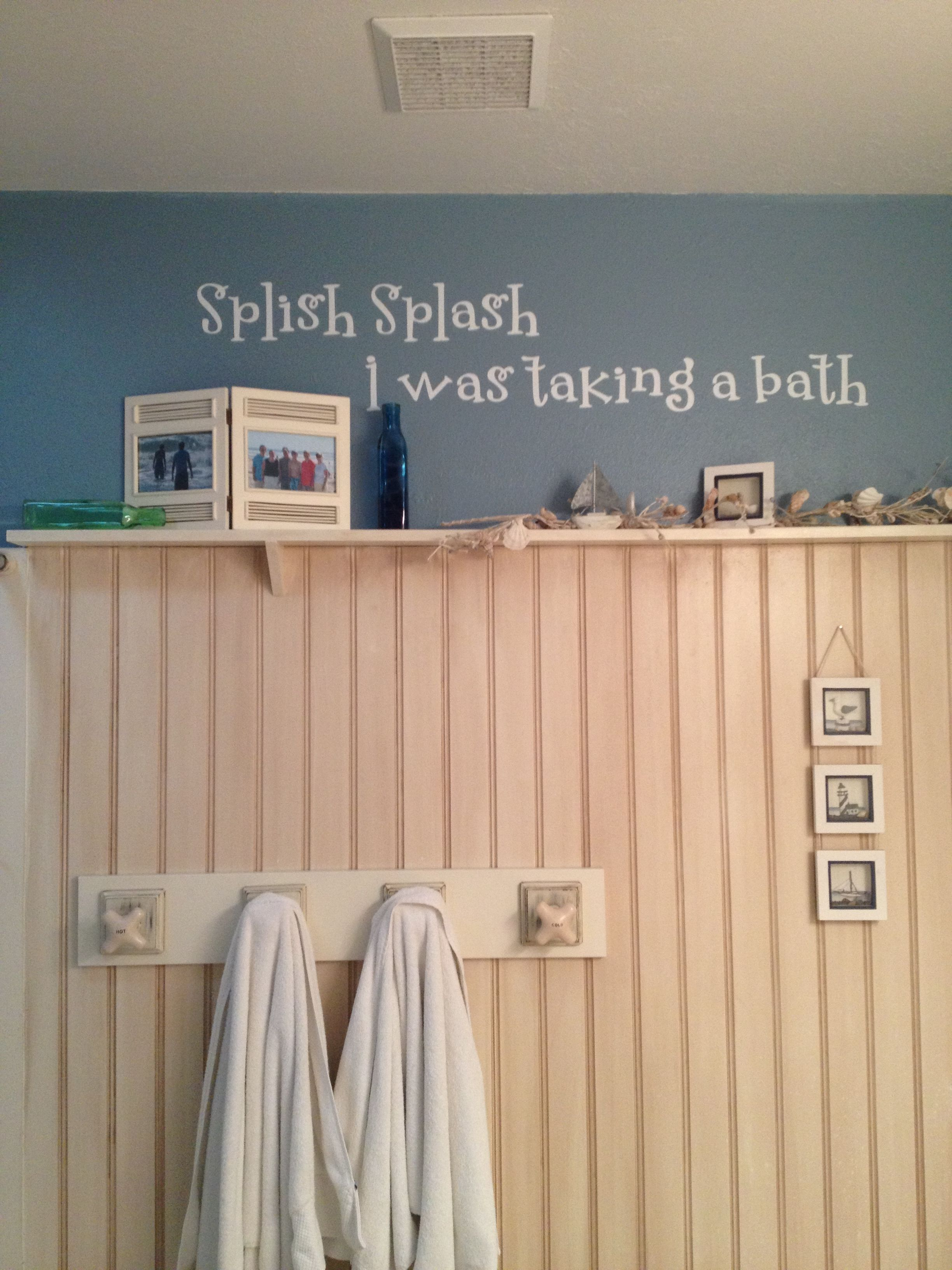 beach themed bathroom. 3/4 of wall covered with bead board