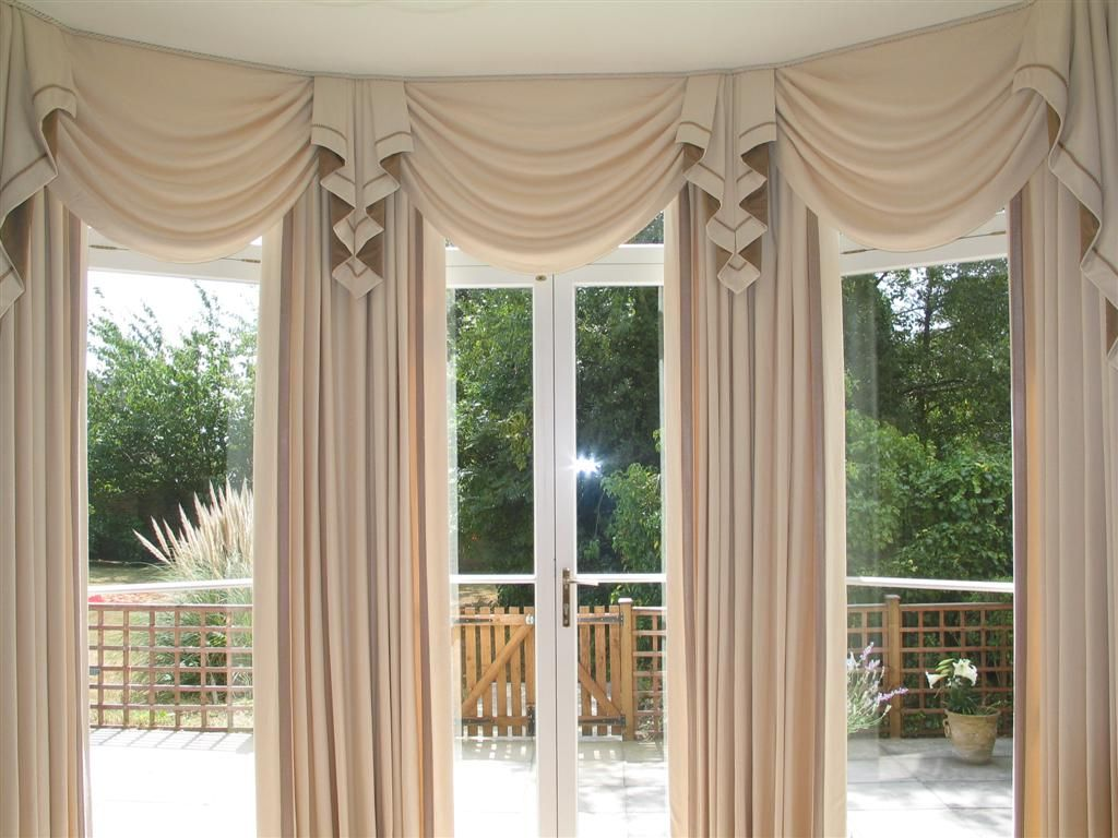 Swag curtains for living room large bay window curtains for Arched bay windows