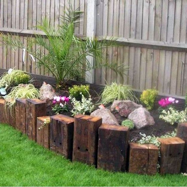 Rustic Softwood Sleeper used to create a plant border ...