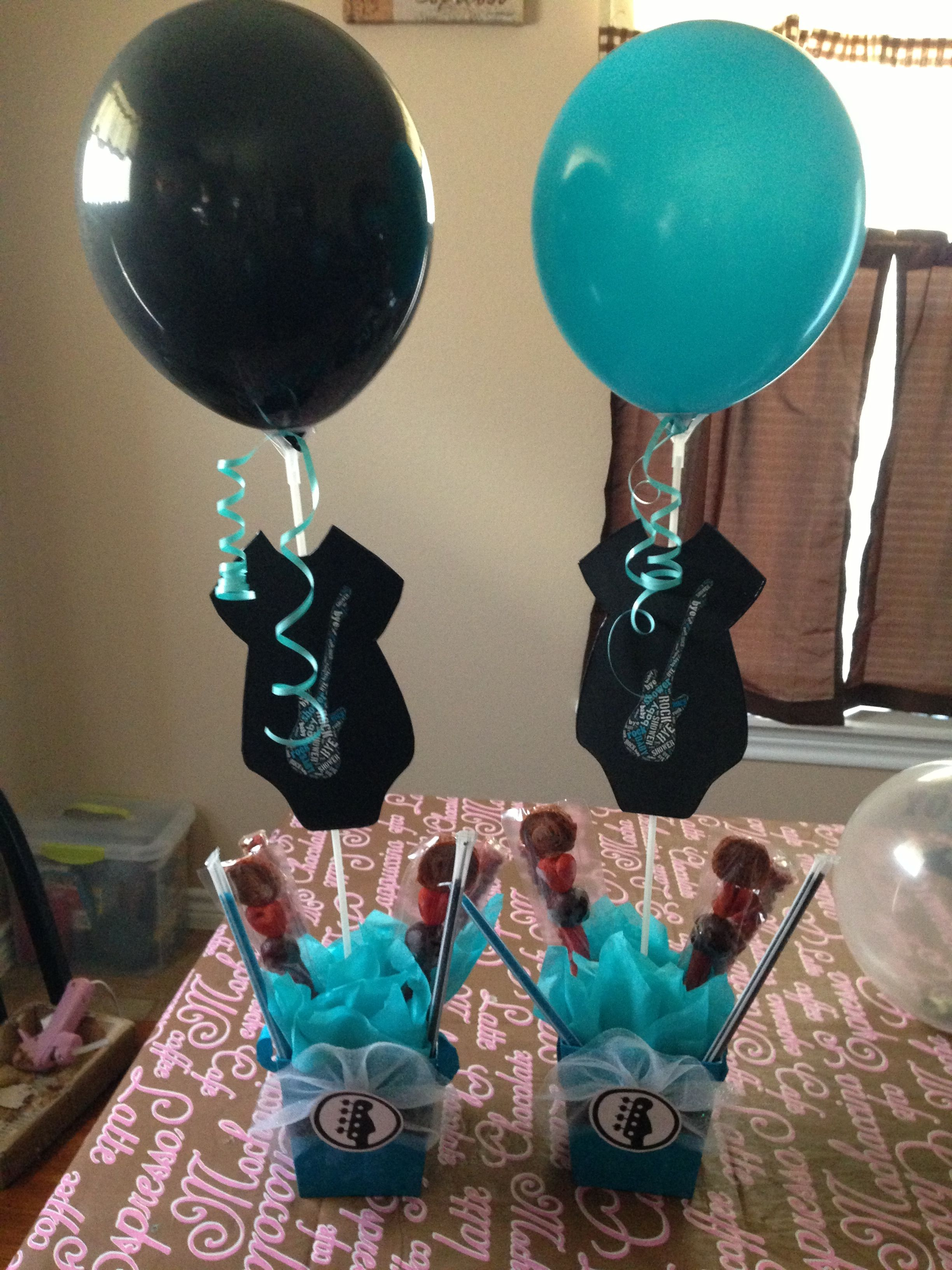 Rock a bye Baby Shower Center Piece no guitar on the onsie and diff color scheme but I like the idea