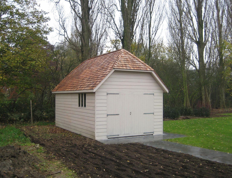 Suffolk timber garage with cedar shingle roof