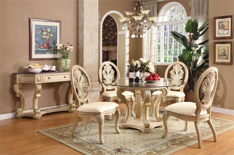 5 Pc Coronado Collection White Wash Finish Wood Round Glass Top 4 Leg Pedestal  Dining Table Set With Fabric Upholstered Chairs With Decorative Carved  Backs.