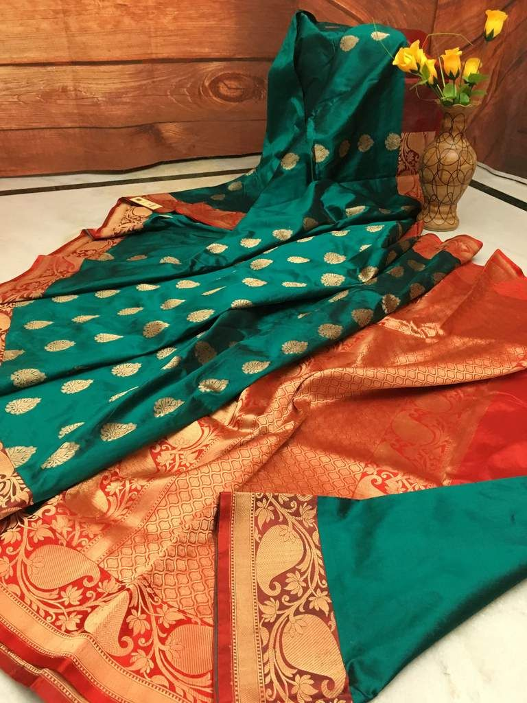 7f3c4aa69bc0a6 Turquoise Green color pure Katan Banarasi silk saree in Red combination  keeps the traditional Banarasi essence within a fashionable wrap. All over  body ...
