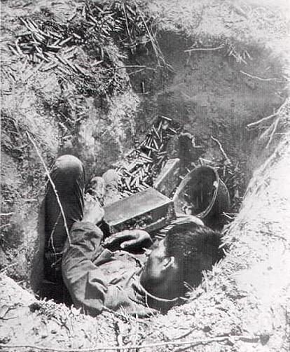 FOUGHT TILL THE END - A Vietnamese machine gunner lies dead in his ...