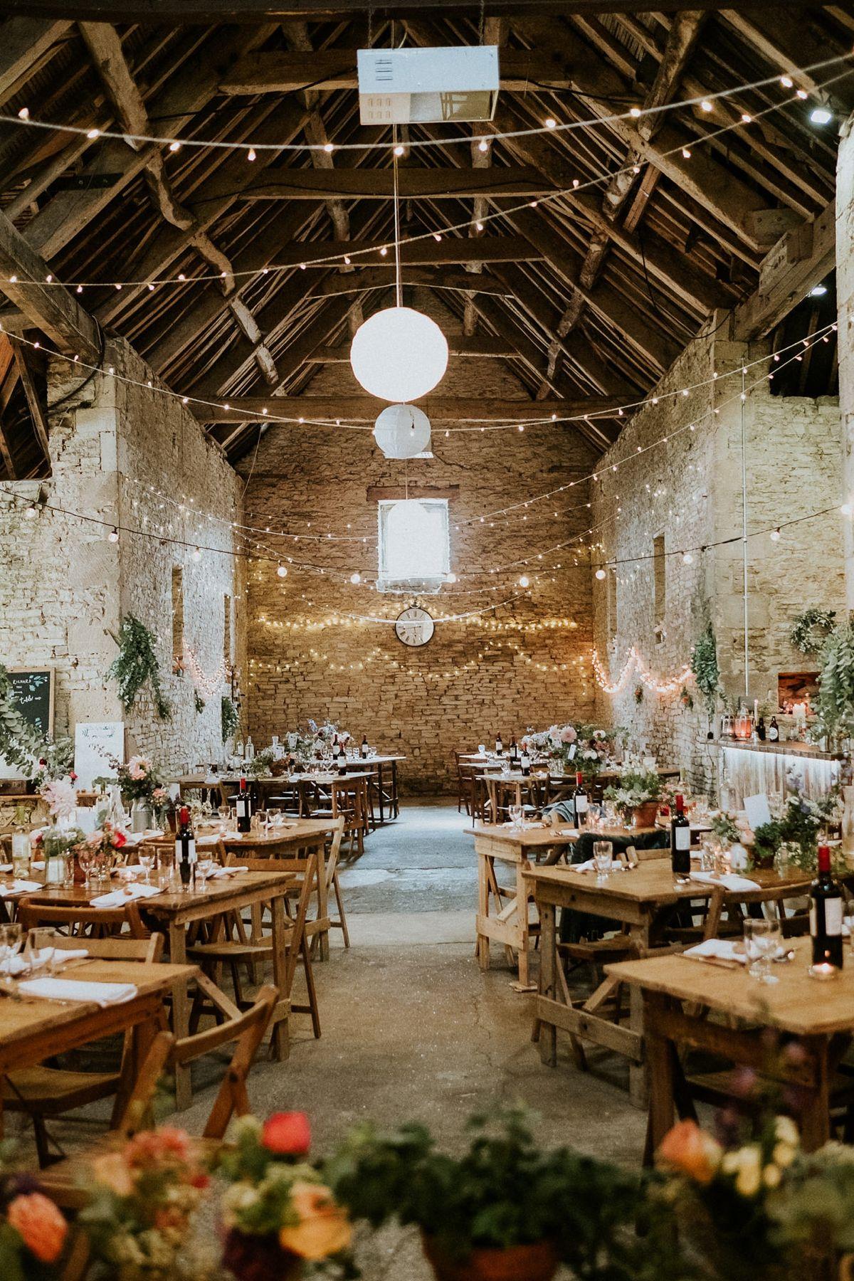 A Feminist Wedding with a Barn Full of Fairy Lights + an Indiebride London Dress #barnweddings