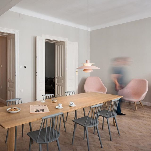 This Vienna apartment, renovated by Slovenian architects Kombinat, features a hybrid living space with room for both cooking and working. Read the full story on dezeen.com/interiors #interiors #renovations Photograph is by Janez Marolt.