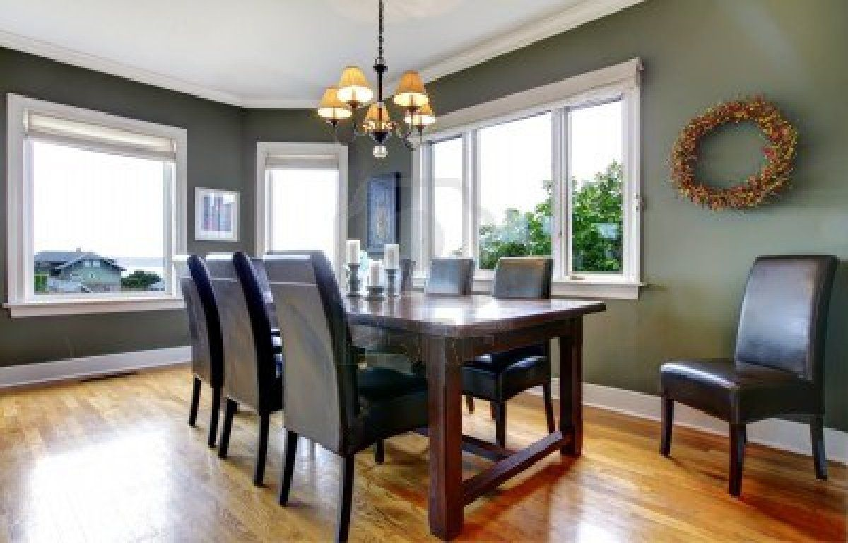 large green dining room design with leather chairs and windows