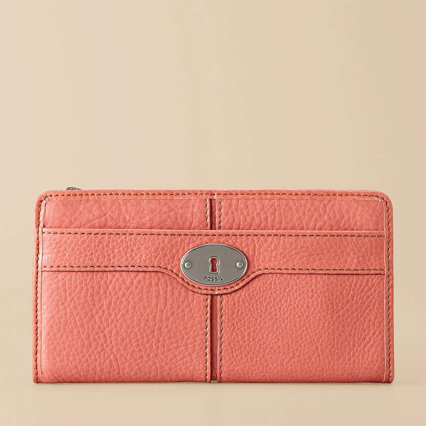 Made with smooth glazed leather and available in several charismatic colors, the Maddox zip clutch is a modern vintage must-have.