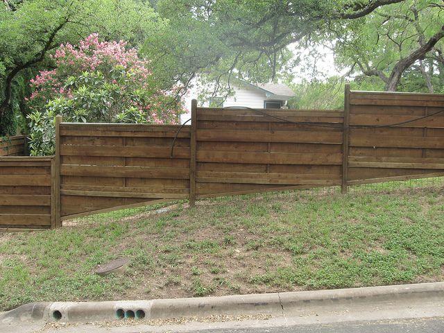 Wood Fence On Slope With Images Sloped Yard Backyard Fences