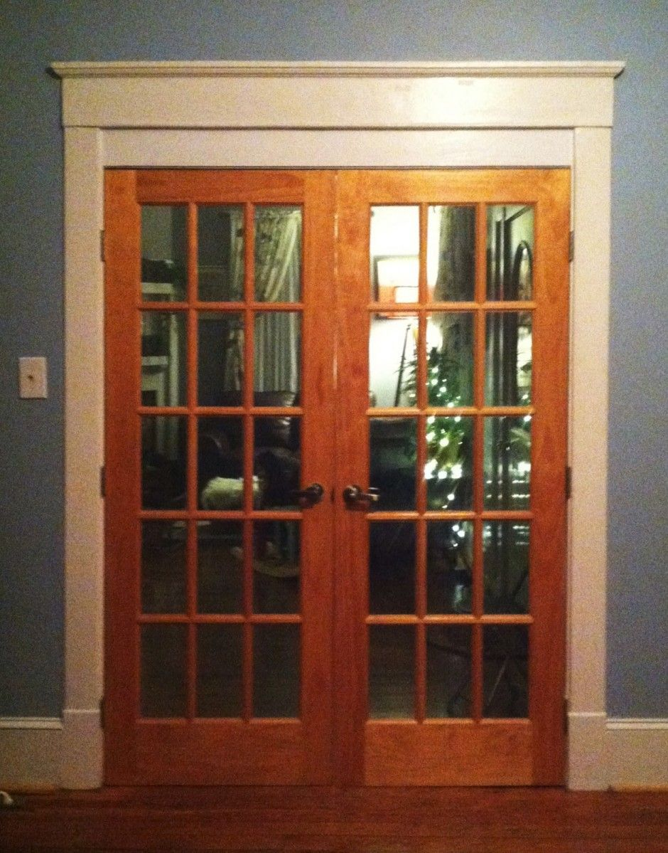 Interior Double Glass Door With Brown Wooden Frame And Bars Placed On The White Gray Wall Also Brown Wooden F Entry Door Designs French Doors Wood French Doors