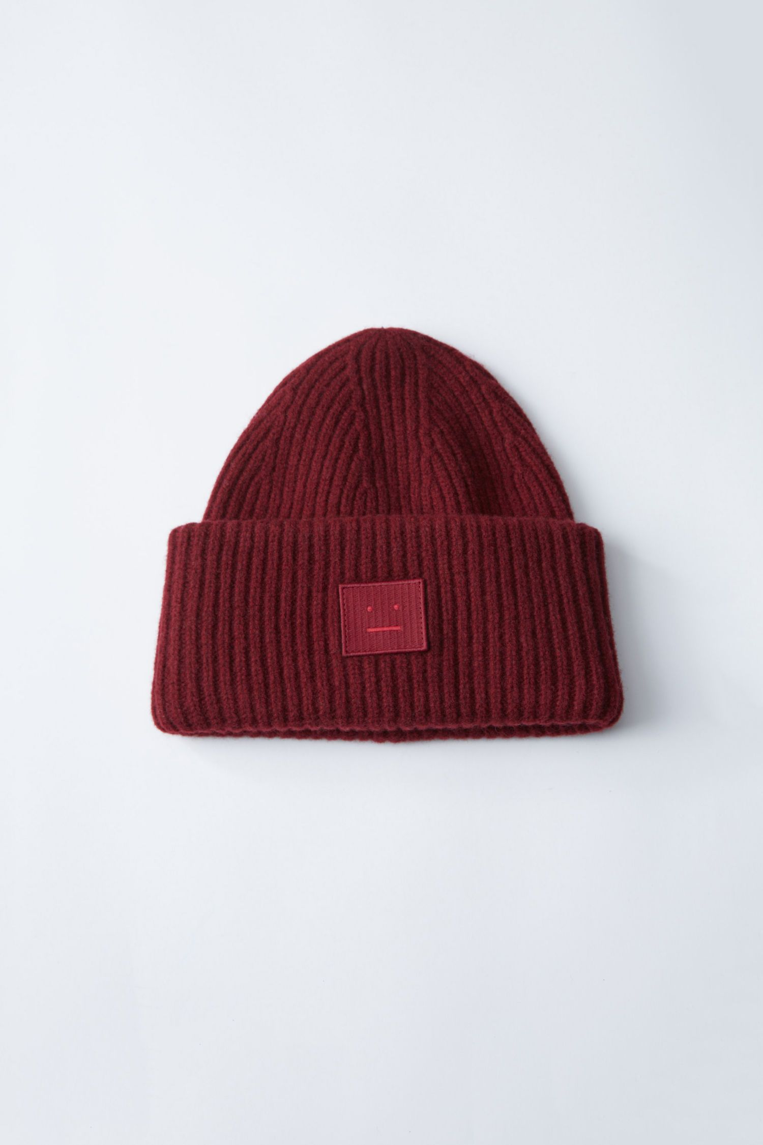 66a6b4ce88c Acne Studios Pansy burgundy is a street style ribbed beanie hat.  Accessories Pansy Face Burgundy 1500x 001