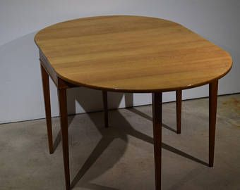 An early mid century drop leaf table by Frits Henningsen six legs