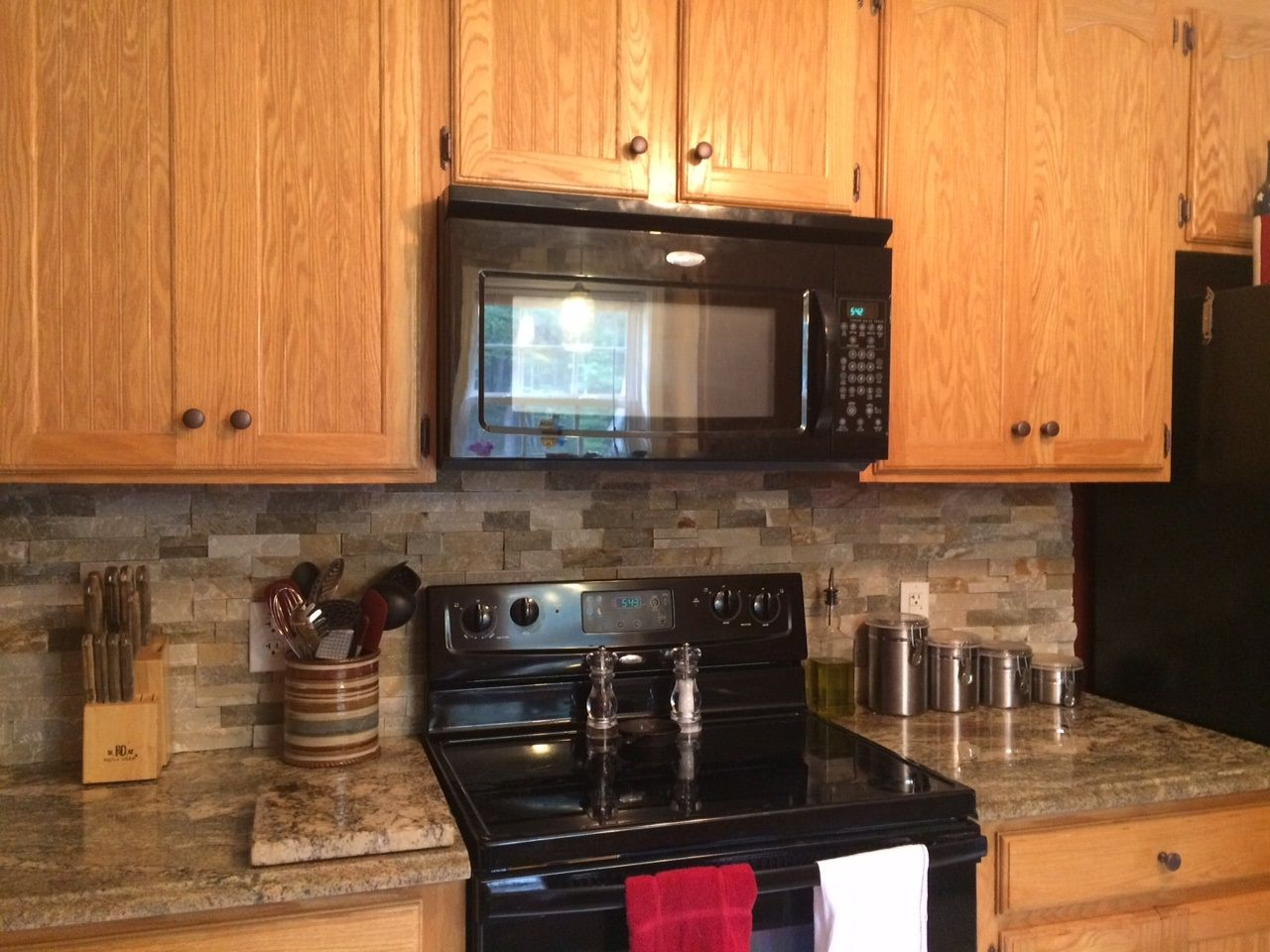 River Bordeaux Granite Countertops And Desert Sand Stone Backsplash