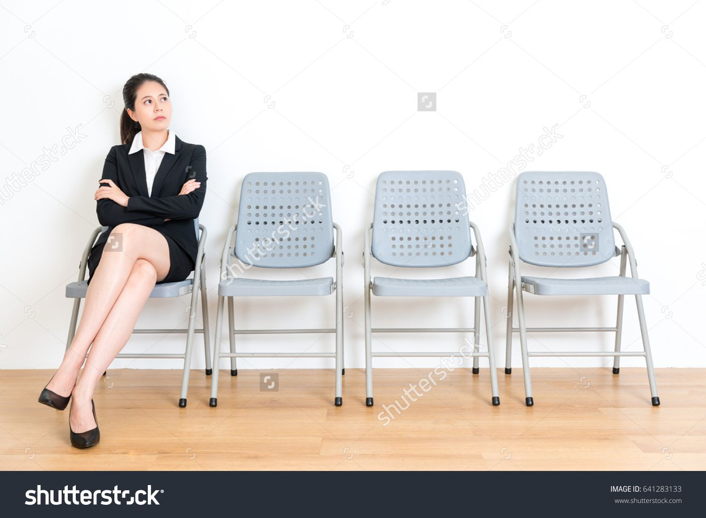 lovely elegant business girl waiting for interview sitting on wood